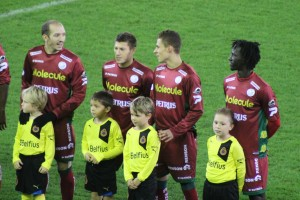 Zulte Waregem's Thorgan Hazard and Franck Berrier share a joke, Mbaye Leye looks on